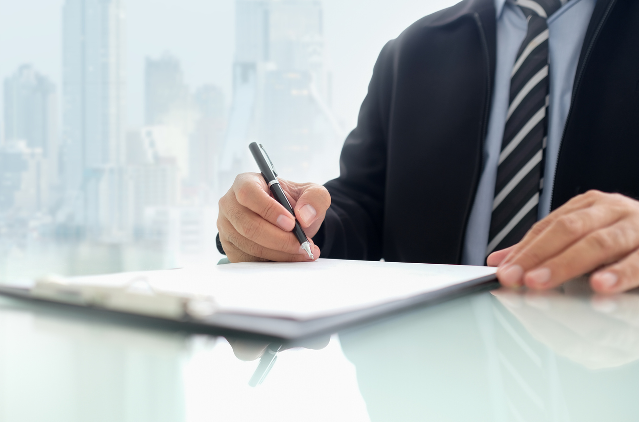 businessman signing contract or agreement business deal.