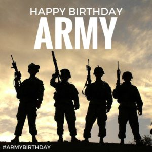 Soldiers in silhouette on hill for Army birthday