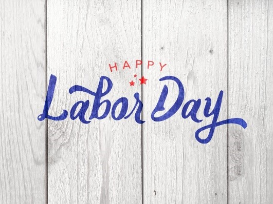 Happy Labor Day written on a white wooden background