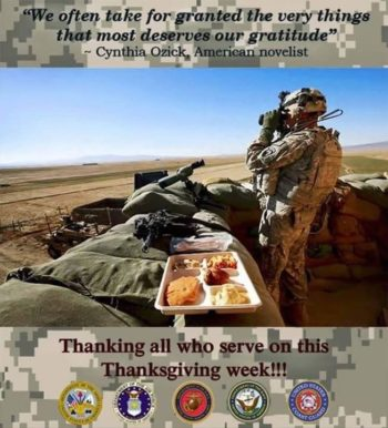 Service member in uniform looking through binoculars, tray of food sitting next to service member as he works, thanking all who serve on this thanksgiving week!