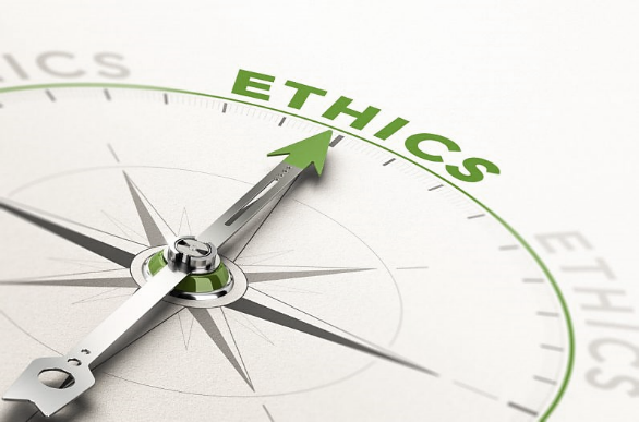 """Compass, needle pointing towards the word """"ethics"""" written in green"""